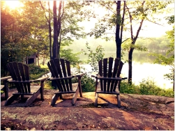Muskoka chairs on Georgian Bay rock and coffee in the morning.